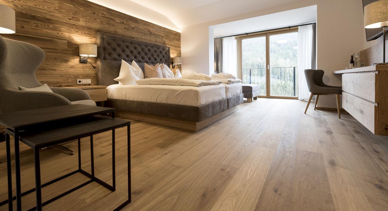 Interiér hotelového pokoje Naturhotelu Edelweiss Wagrain